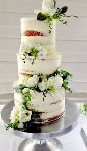 Naked Wedding Cake Adorned With Fresh Flowers Leaves Luscious Lemon Layered Yummy Swiss Meringue Buttercream Made By Florabunda