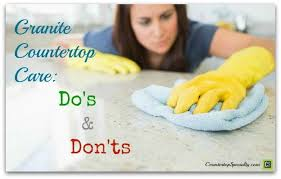 granite countertop care do s & don ts woman cleaning granite