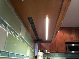cabinet lighting with integrated outlets power built in