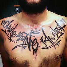 Graffiti Street Art Tag Chest Mens Tattoo In Black Ink