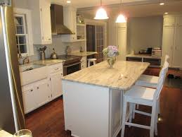 Elegant Kitchen Table Decorating Ideas by White Springs Granite With White Cabinets And Wooden Flooring