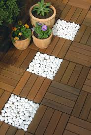 contrasting white pebbles with ipe wood swiftdeck tiles outdoor