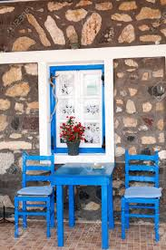 Blue Table And Chairs For Two In Front Of Stone Wall, Santorini.. 12m Kids Adjustable Rectangle Table With 6 Chairs Blue Set Chairs Table Stock Illustration Illustration Of Wall Miniature Hand Painted Chair Dollhouse Ding And Bistro The Door Bart Eysink Smeets Print 2018 Rademakers Spring Daffodills Stock Photo Edit Now 119728 Mixed Square 4 With Four Rose Seats Duck Egg Blue Roses Twelfth Scale Miniature Wooden And In Greek Restaurant Editorial Little Tikes Bright N Bold Greenblue Garden Bluegreen Resin Profile Education