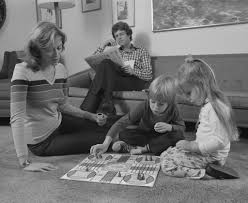 Detail Of Family Mother Kids Playing Board Game Living Room Floor Father Reading Newspaper By Corbis