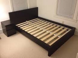 ikea malm queen bed frame and matching night stand in goose island