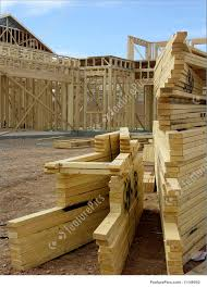 100 House Trusses Construction Building Construction Stacks Of Roof Trusses In Front Of Clearly Visible Framed House
