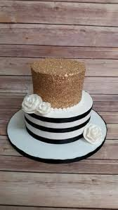 Gold sequins and black and white stripe cake buttercream