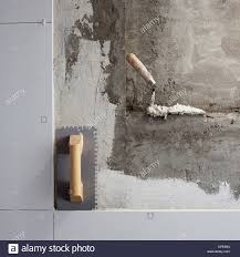 construction tools notched trowel on tiles mortar wall stock photo