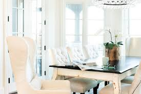 white french dining table with black top and white tufted dining