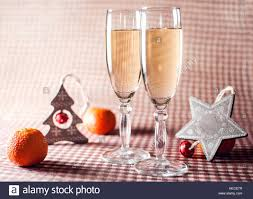 Image Of Two Wineglasses Champagne Decorative Wooden Star And Tree Mandarins On The Red Checkered Background Rustic Style