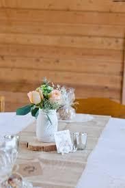 Table Centerpieces From A Rustic Floral 1st Birthday Party Via Karas Ideas KarasPartyIdeas
