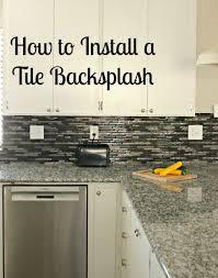 how to install a glass tile backsplash she buys he builds