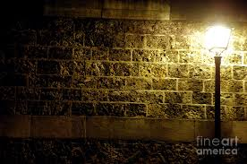 l and a brick wall photograph by may