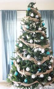 I LOVE This Coastal Christmas Tree Such Cute Ornaments And What A Great Idea To Use Burlap Garland
