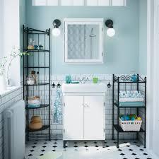 Small Narrow Bathroom Ideas by Tall Narrow Shelving Unit Beside Fabulous White Bathroom Vanity
