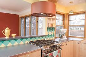 a colorful midcentury kitchen remodel featuring b w tile in a