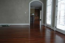 gorgeous wood flooring combined with solid wall painted in