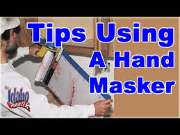 Using A Paint Sprayer For Ceilings masking the ceiling to spray walls using a hand masker to mask