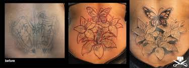 Awesome Lily Flowers With Butterfly Cover Up Tattoo On Lower Back