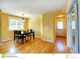 Bright Yellow House Interior Dining Area With Wooden Table And