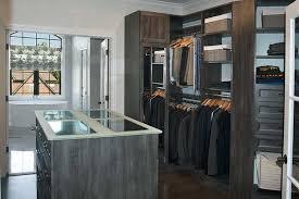 bathroom with walk in closet or walk through closet to bathroom