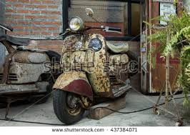 BANGKOK THAILAND JUNE 12 2016 Old Vintage Rusty Vespa Parked In Front Of Warehouse