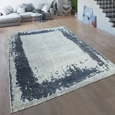 wohnzimmer teppich moderner kurzflor mit bordüre meliert in grau und blau
