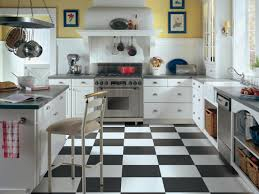 Vintage Yellow Kitchen Design With Interesting Black And White Floor Tiles Also L Shaped Painted Wooden Island By Using Brushed Nickel Cup
