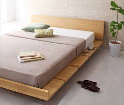 The Amaya Wood Bed Frame is a Japanese themed platform bed with a