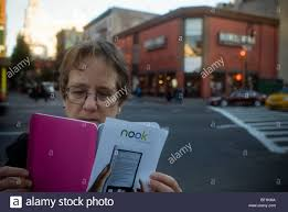 A Shopper Looks At A Brochure For The New Barnes & Noble Nook ... Barnes Noble Pushing Eader Market Forward With New Nook Zdnet Glowlight Plus Review If It Were Made By Anyone Other Than 1st Edition Wikipedia Ebook Reader Prd07t20wbl1 User Guide Simple Touch Bnrv300 6inch Tabletninja A Shopper Looks At A Brochure For The Glowlight Quick How To Find Hidden Browser On The Barnes And Noble Return Policy Without Receipt 28 Images Put Free Epub Books Your Nook Youtube Nobles Is Waterproof Made Of 2gb Wifi 6in Black Ebay