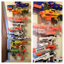 Diy Gun Cabinet Plans by Diy Nerf Gun Rack Used A Ladder From An Old Bunk Bed Used