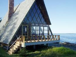 This charming A frame cottage is situated on a rocky peninsula
