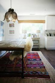 Design Lessons How To Layer Rugs Like a Champ