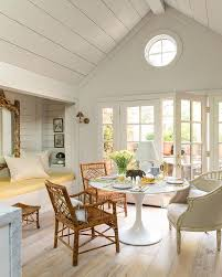 Chic Dining Room Features A Shiplap Vaulted Ceiling Placed Over Built In Reading Nook Alcove Filled With Yellow Cushion Under Gilt Mirror