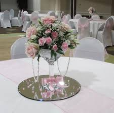Elegant Fresh Wedding Flowers Centerpiece On Luxury Glass Roound Platter Combined With Lovely Pink Ribbon And Beautiful Light