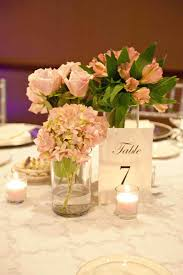 Lantern Centerpiece With Flowers Cascading Out View The Gorgeous Babyus Breath On Wooden I Love