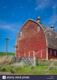 The Palouse, Whitman County, Washington: Red Barn With Round Roof ... Red Barn Washington Landscape Pictures Pinterest Barns Original Boeing Airplane Company Building Museum The The Manufacturing Plant Exterior Of A Red Barn In Palouse Farmland Spring Uniontown Ewan Area Usa Stock Photo Royalty And White Fence State Seattle Flight Interior Hip Roof Rural Pasture Land White Fence On Olympic Pensinula