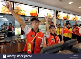 Employees Of McDonalds Gesture In The Dining Room Olympic Village Beijing China