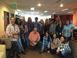 Participants in a Plaid Spirit Day Optimal Home Care Denver CO