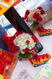 Some Little Manthemed Rain Boots With And We Fire Truck Flower Arrangement Filled