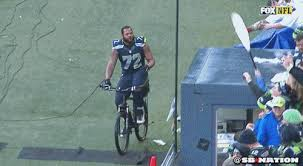 Michael Bennett Takes A Sideline Bike Ride After Seahawks Win
