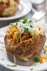 These Chicken Enchilada Baked Potatoes Are Loaded With Saucy Shredded Cheese Sour Cream