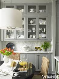 Glass Front Cabinets Make For A Stylish Storage Area In This Texas Kitchen