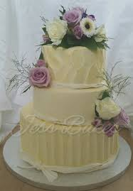 Image A Rustic Buttercream Cake With Fresh Flowers