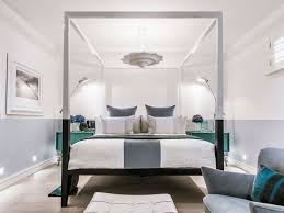 Modern Bedroom With Sleek Canopy Bed By Kelly Hoppen Interiors