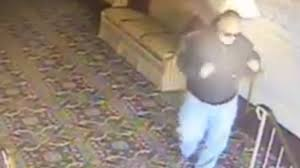 Police Man steals officer s sunglasses at funeral home