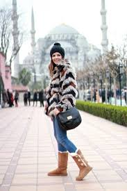 With Faux Fur Coat Beanie Skinny Jeans And Black Leather Bag