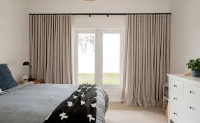 Photo Of Bedroom Decor With Soft Pleated Drapes Pooling On Floor