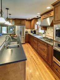 Awesome Hanging Lamp Above Kitchen Island With Sink At Traditional On Wooden Flooring