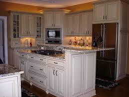 glass countertops antique white kitchen cabinets lighting flooring